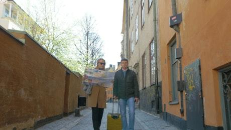 Couple following a map through town