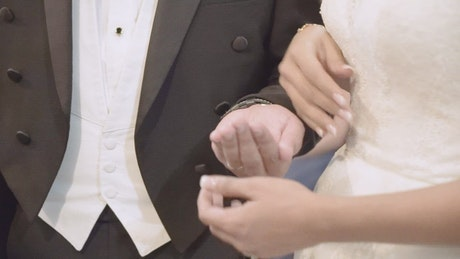 Couple holding hands during their wedding ceremony