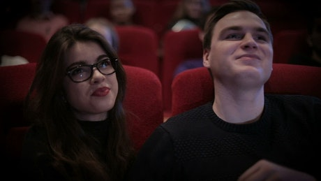 Couple in love watching a movie at the cinema