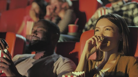 Couple laughing during a comedy film