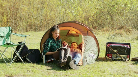 Couple laying in a small tent