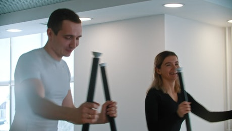 Couple of friends doing cardio exercise in the gym