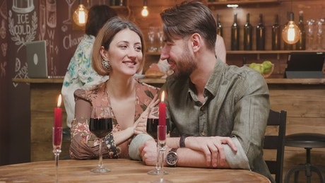 Couple on a date sharing wine