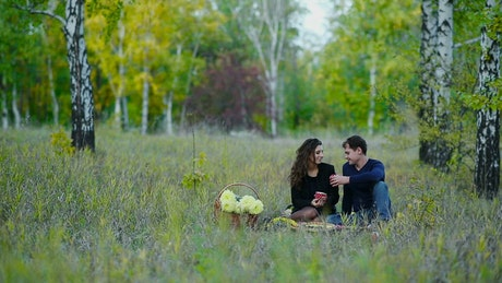 Couple on a picnic in the middle of nature