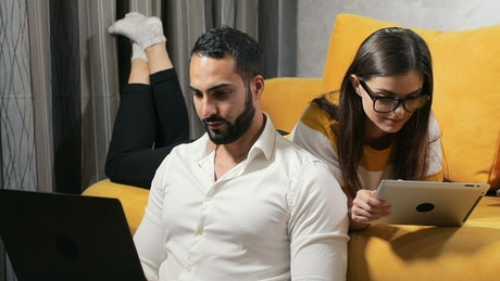 Couple on laptop and tablet work during lockdown