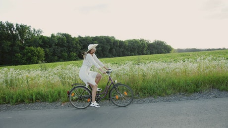 Couple on romantic bike ride in spring countryside