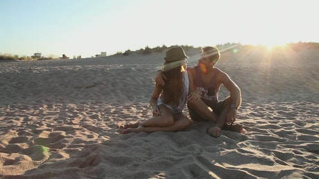 Couple on the beach during sunset