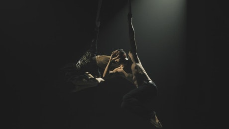 Couple performing on circus ropes
