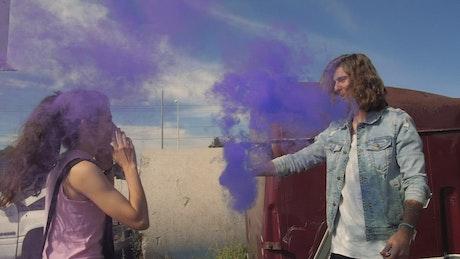 Couple playing with a smoke