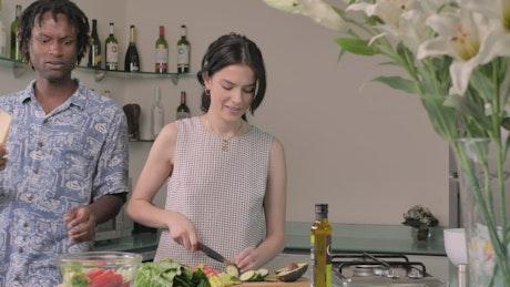 Couple preparing salad at home