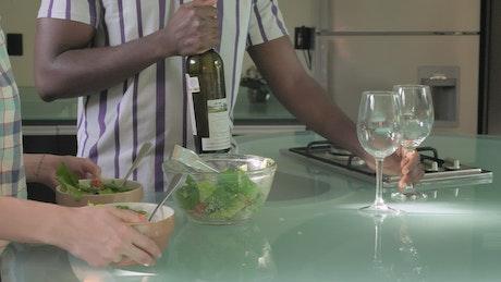 Couple preparing salad for dinner