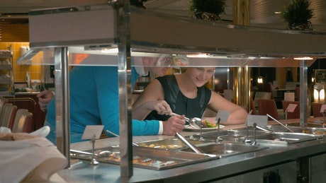 Couple selecting food from a buffet