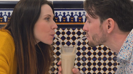 Couple sharing a milkshake