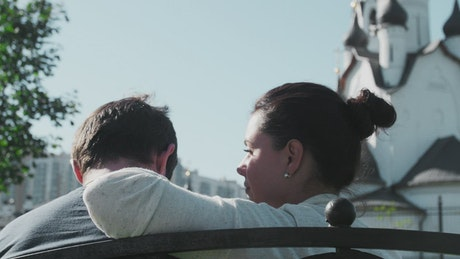 Couple sitting in a Churchyard