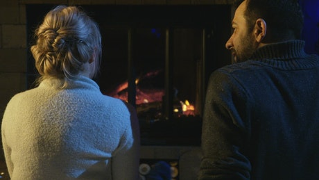 Couple sitting in front of the fireplace