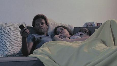 Couple sleeps on couch