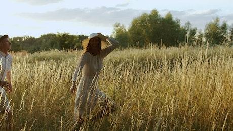 Couple take romantic run through country field