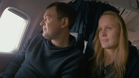 Couple travelling in a plane