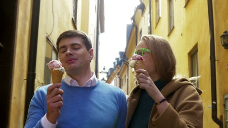 Couple walking around town with ice cream