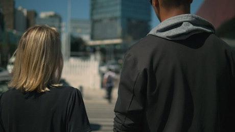 Couple walking on a crosswalk