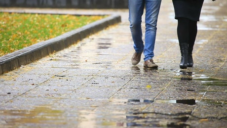 Couple walking on a rainy day, low view