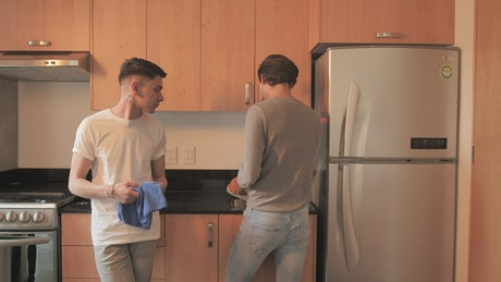 Couple washing the dishes