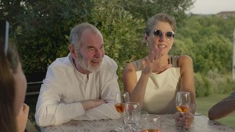 Couples talking over dinner