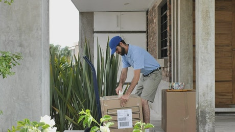 Courier worker preparing boxes on a loading truck