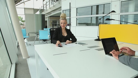 Coworkers sharing desk at office