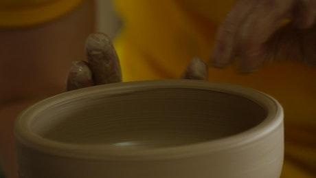 Craftsman making a clay vase