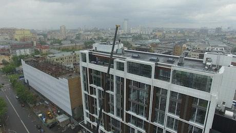 Crane lifting window panels