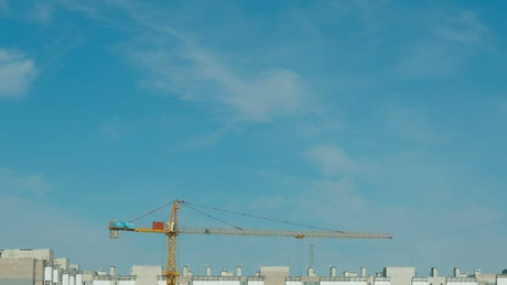Cranes moving in a construction site