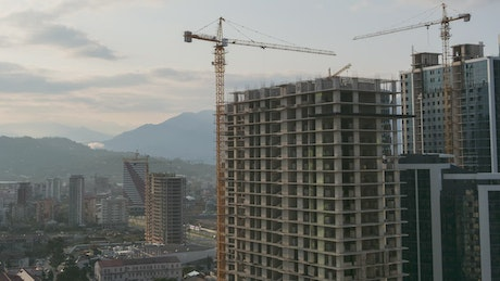 Cranes working at a construction site time lapse