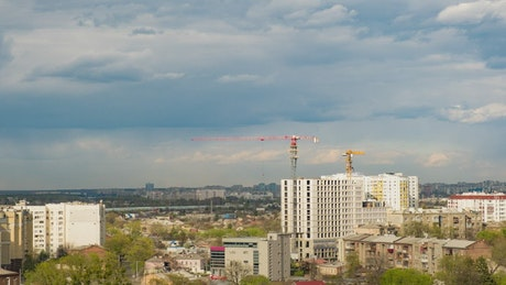 Cranes working on a building under construction