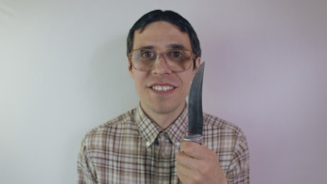 Crazy nerd with a knife