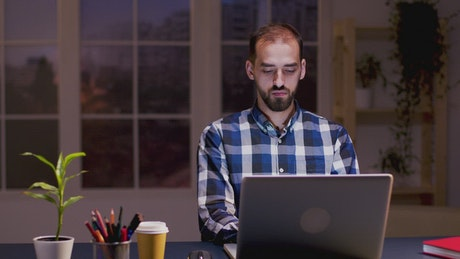 Creative man thinking about work project at desk