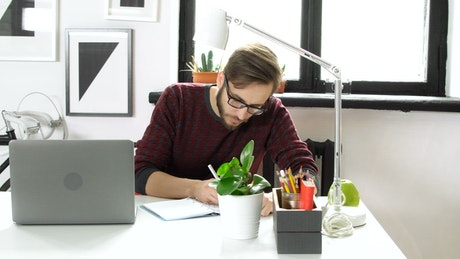 Creative man works on web design in modern office