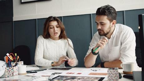 Creative woman presents interior design to client