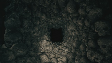Creepy dark cave full of skulls