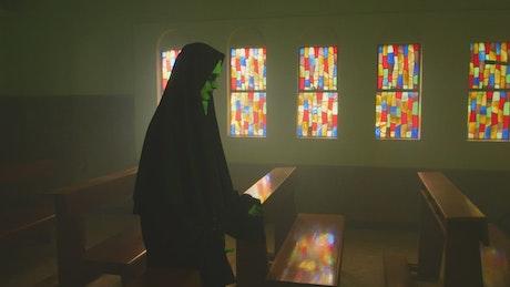 Creepy ghost nun inside a church