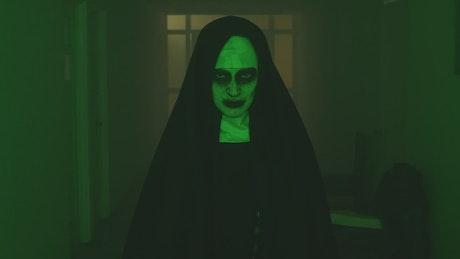 Creepy ghost nun walking looking at the camera