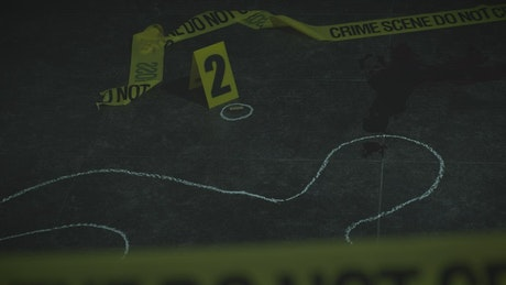 Crime scene with evidence and a silhouette marked in chalk