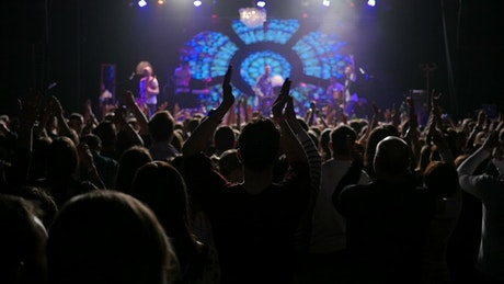 Crowd clapping at a concert