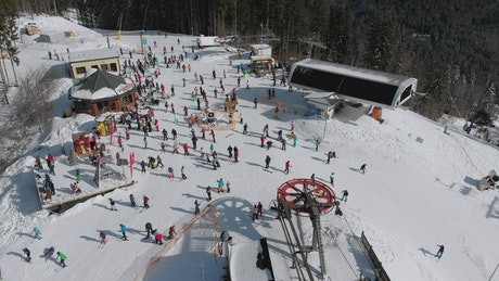 Crowd of skiers in the top of the mountain