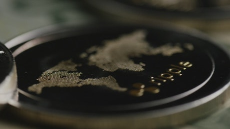 Cryptocurrency coins and dollar bills close up