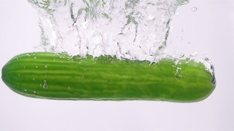 Cucumber falling through water
