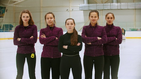 Curling team in a photoshot at an ice rink