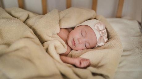 Cute little baby having a nap