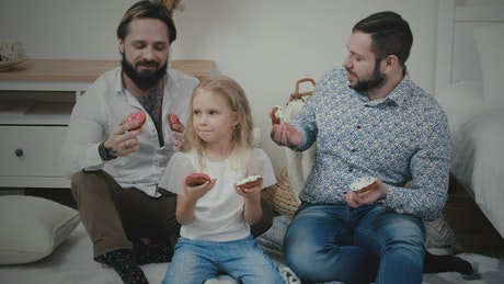 Cute male couple with little girl