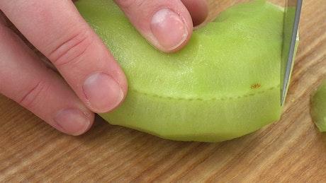 Cutting a Kiwi into chunks